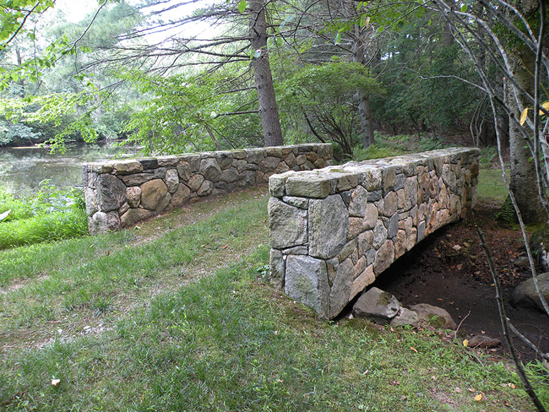 side view of handbuilt stone bridge
