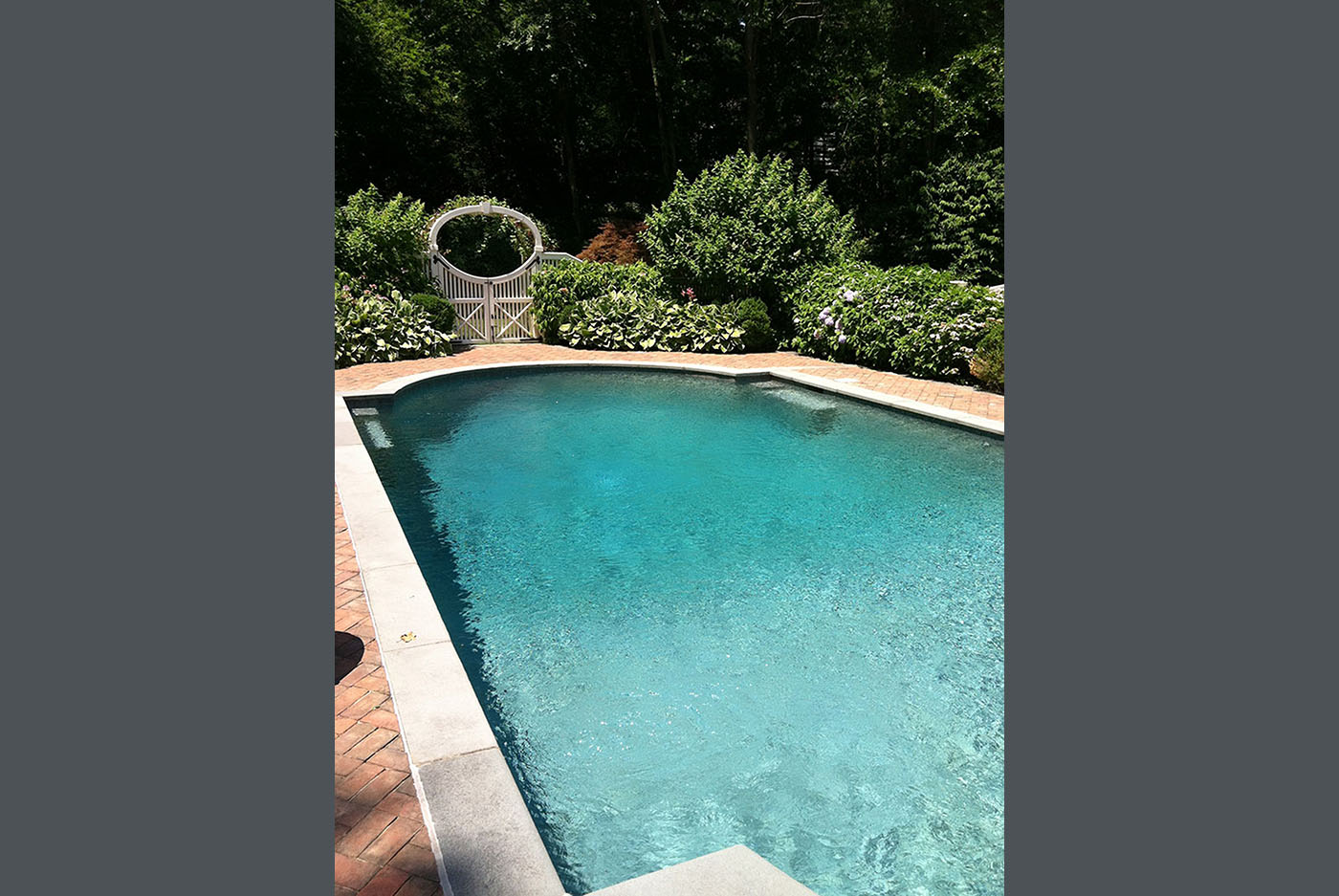 long swimming pool in backyard