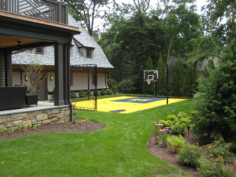 outdoor michigan style basketball court in backyard