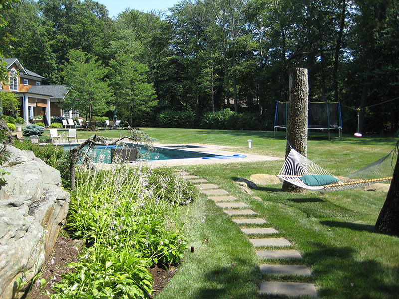 large backyard with hammock and pool