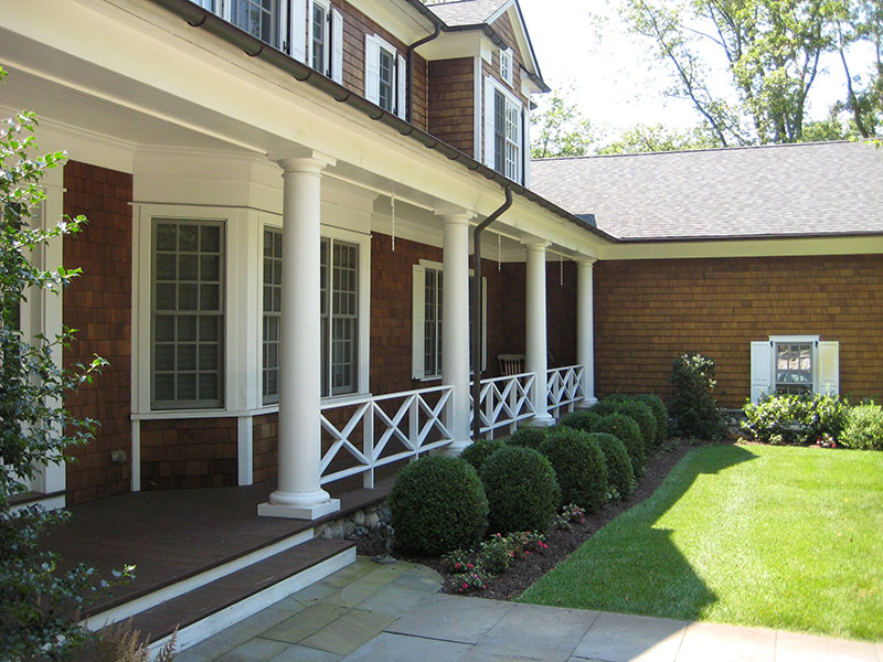 white columns in front of house