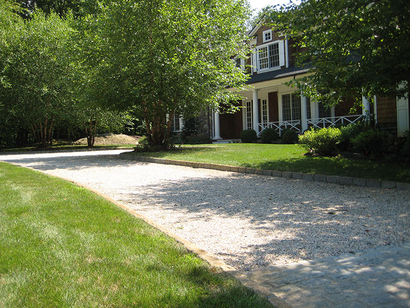 pebblestone driveway in front of house