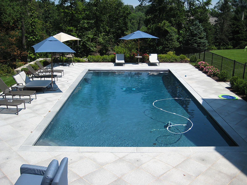 wide view of pool with gray patio width