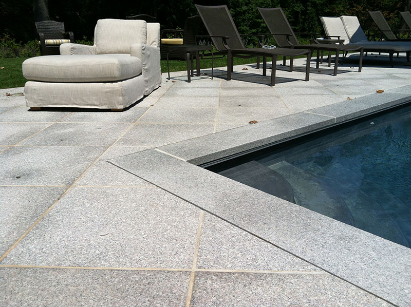 gray stone patio around pool